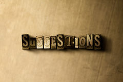 SUGGESTIONS - close-up of grungy vintage typeset word on metal backdrop royalty free illustration