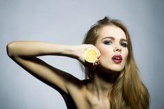 Suggestive blonde girl portrait with orange Royalty Free Stock Photos