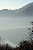 An suggestive view of Lake Iseo at sunset with the fog Royalty Free Stock Photography