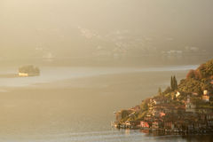 An suggestive view of Lake Iseo at sunset with the fog Royalty Free Stock Images