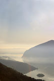 An suggestive view of Lake Iseo at sunset with the fog Stock Photo