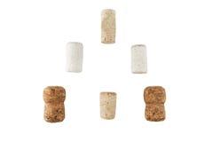Sugheri del champagne e del vino isolati su bianco Fotografia Stock
