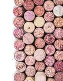 Sugheri del vino isolati su bianco Immagini Stock