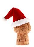 Sughero di Champagne nel Natale Santa Hat Immagine Stock