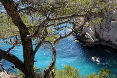 Sugiton. People in a canoe on the blue water of the calanques Stock Images