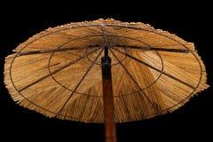 Sugrörstrandparaply Arkivfoto