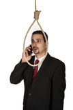 Suicidal businessman contemplating hanging. Because of phone call royalty free stock images