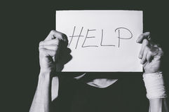 Suicidal depression. Man holding help sign paper. Help. Suicidal depression. Man holding help sign paper. Black and white royalty free stock images