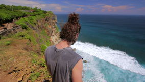 suicidal young man at the edge of cliff Royalty Free Stock Photos