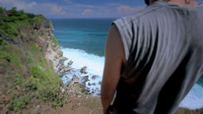 suicidal young man at the edge of cliff, retouched stock video footage