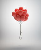 Suicide balloons. Gallows suspended by a bunch of red balloons Stock Photos