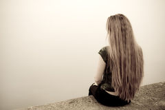 Suicide concept - back of sad depressed woman. Back of suicidal depressed young woman Stock Images