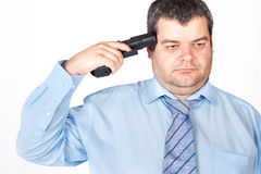 Suicide concept -  man pointing a gun at his head Stock Photography