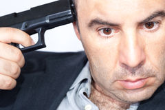 Suicide concept -  man pointing a gun at his head Royalty Free Stock Images