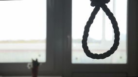 Suicide, depressed man, gallows noose around his neck stock video footage