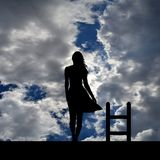 Suicide and depressive disorder concept with silhouette of woman. Suicide and depressive disorder concept with depressed woman on the roof contemplating suicide royalty free illustration