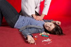Suicide. Emergency actions - cardiac massage. Stock Photos