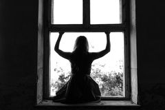 The suicide girl wants to jump out of the window Stock Image