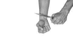 Suicide. Man want to commit suicide. By cutting his veins with knife. Black and white. Isolated on white background Royalty Free Stock Photo