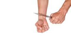 Suicide. Man want to commit suicide. By cutting his veins with knife. Isolated on white background royalty free stock photos