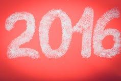 Suiker in de vorm van nummer 2016 rode document achtergrond Christma Stock Foto's