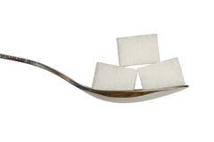 Suiker drie cobes op een theelepeltje Royalty-vrije Stock Afbeelding