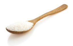 Suiker en lepel op wit Stock Fotografie