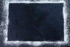 Suiker op de zwarte close-up van de planraad stock foto