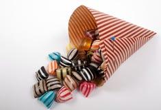 Suikergoed in een Kegel Stock Afbeeldingen