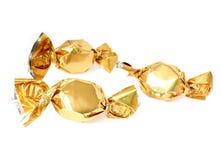 Suikergoed in gouden folie royalty-vrije stock afbeeldingen