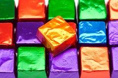 Suikergoed op glanzende omslagenachtergrond Stock Afbeeldingen