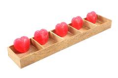 Suikergoedharten in houten doos Stock Afbeeldingen