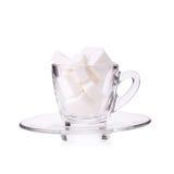 Suikerkubus in koffiekop Stock Afbeelding
