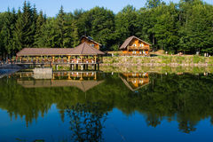 Suior Cottage and Floating Restaurant. Over Suior Lake in romania Royalty Free Stock Images