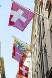 Suisse et drapeaux de Genève Photographie stock libre de droits