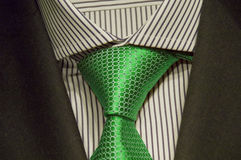Suit 2. Reflecting the tailoring, Joint suit with shirt and green tie Royalty Free Stock Photo
