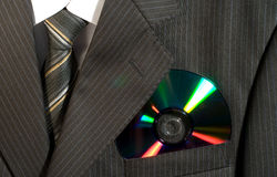 Suit. CD in a pocket of a striped suit stock photos