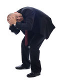 Suit bent over. Man in suit cowering  on white Royalty Free Stock Images