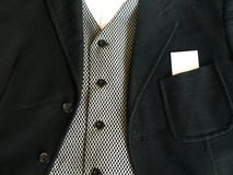 Suit with Blank Card. A formal suit with a blank business card in the pocket stock photography