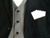 Suit with Blank Cards. A formal suit with a selection of blank business cards in the pocket royalty free stock photography