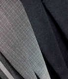 Suits clothing background photo. Suits closeup photo with the clothes background photograph stock photos