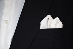 Suit with handkerchief. Close up of a black suit with handkerchief Stock Images