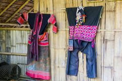 Suit of a hill tribe in thailand house. Background royalty free stock photo