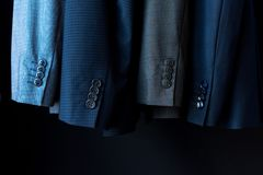 Suit jackets. Close-up view of fashionable suit jackets in boutique Stock Photo