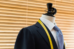 Suit on mannequin. In tailors Shop royalty free stock photos