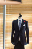 Suit on mannequin. Beside the window Royalty Free Stock Photography