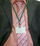 Suit and name tag. Write the text on the white stock images