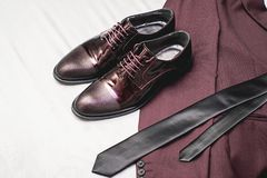 Free Suit, Necktie, Leather Shoes On A White Textile. Grooms Wedding Morning. Close Up Of Modern Man Accessories Royalty Free Stock Images - 110537219