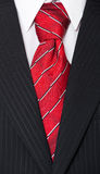 Suit and red necktie Stock Photography