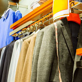 Suit. Row of men's suits hanging in closet royalty free stock photo